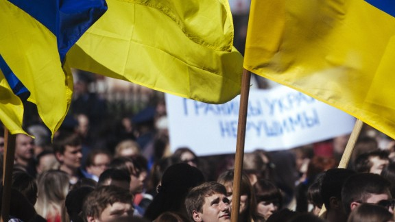A Ukrainian student waves his national flag during a nationalist and pro-unity rally in the eastern city of Lugansk on April 17, 2014.
