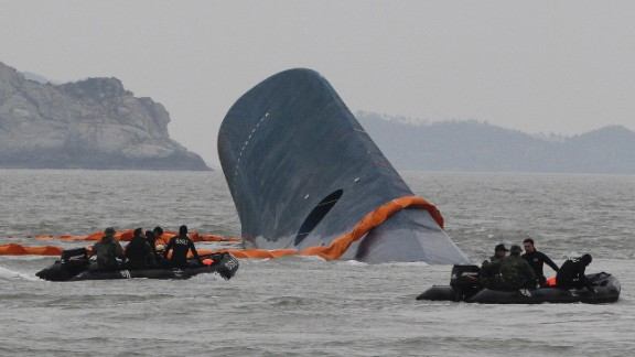 South Korean Coast Guard officers search for missing passengers aboard a sunken ferry in the water off the southern coast near Jindo, South Korea, Thursday, April 17/