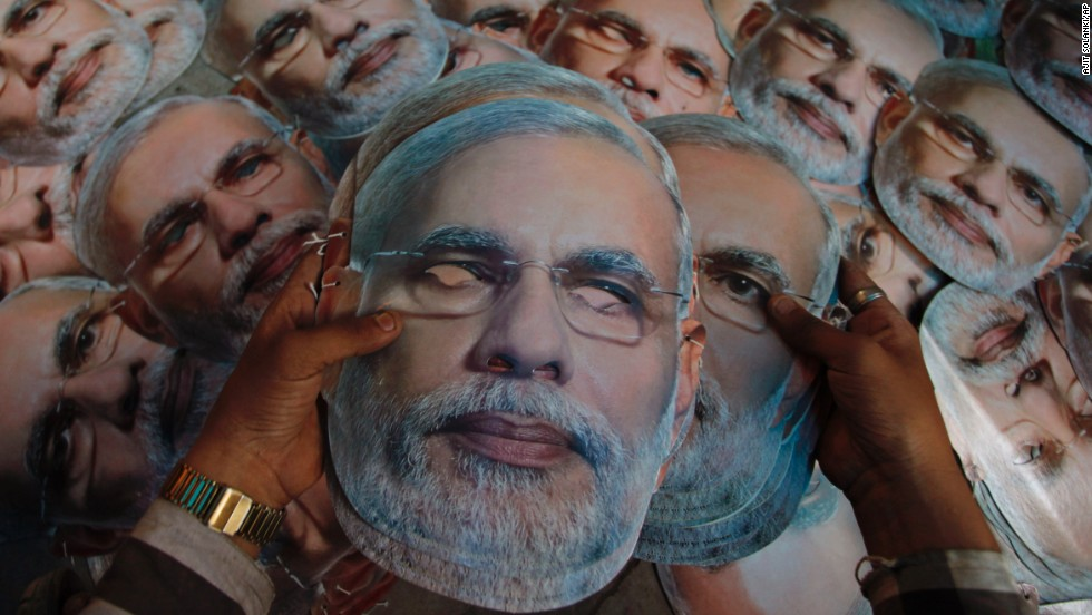A worker arranges masks of Bharatiya Janata Party candidate Narendra Modi at a printing press in Ahmedabad, India, on Saturday, April 12.
