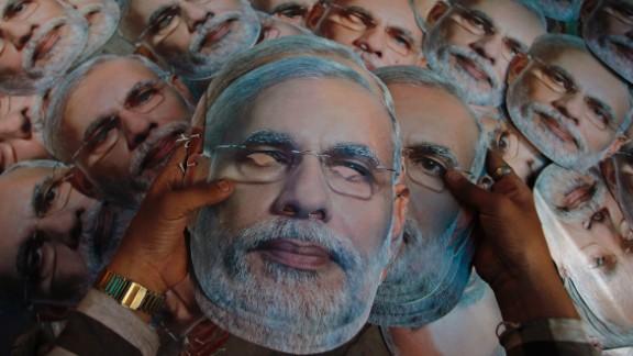 A worker arranges masks of Bharatiya Janata Party candidate Narendra Modi at a printing press in Ahmedabad, India, on Saturday, April 12.