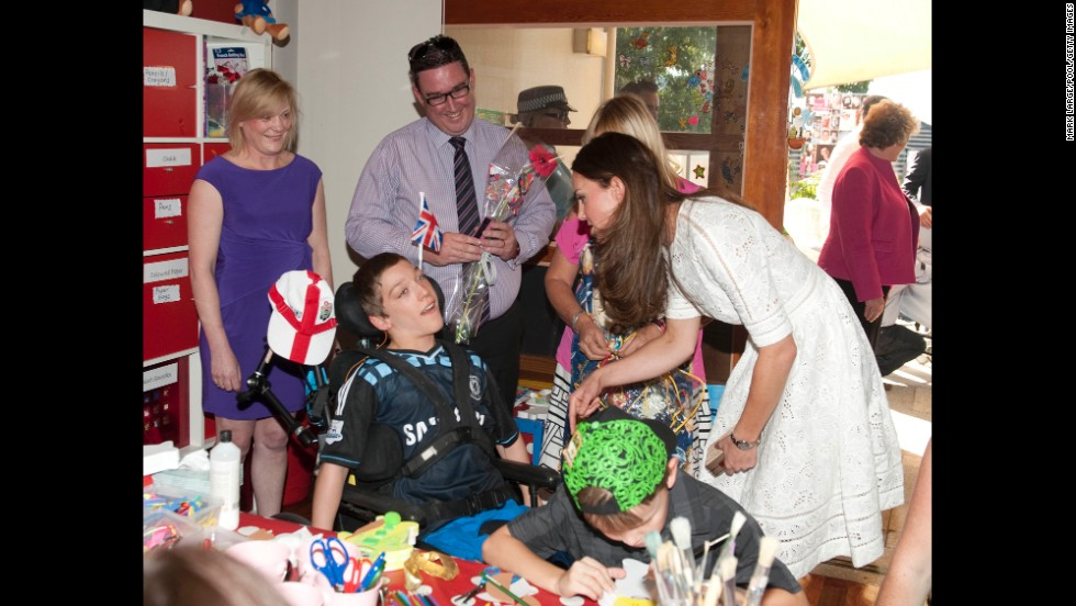 Catherine speaks with a child at the Bear Cottage Hospice on April 18 in Sydney.