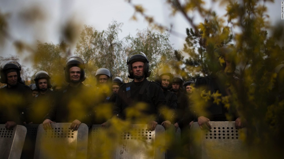 Ukrainian riot police officers stand guard during a pro-Ukrainian demonstration in Donetsk on April 17.