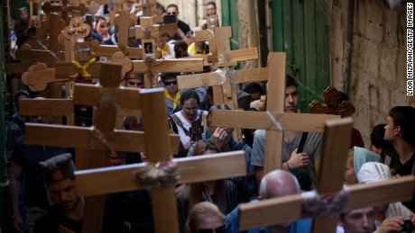Orthodox Christian pilgrims hold wooden crosses as they take part in the Good Friday procession along the Via Dolorosa in Jerusalem.