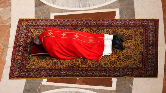 Pope Francis lies on the floor in prayer before presiding over a Good Friday service in St. Peter's Basilica.