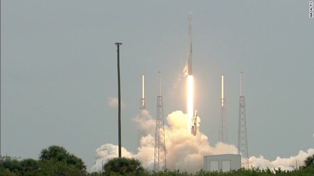 SpaceX rocket soars toward space station