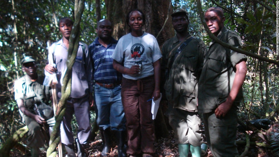 "Kalema-Zikusoka (pictured center) poses with a group of trainee rangers in May 2008. Kalema-Zikusoka says that  when the conservation land was established, many people who were previously poachers were employed as rangers and trackers. ""We call them 'born again poachers,"" she says."