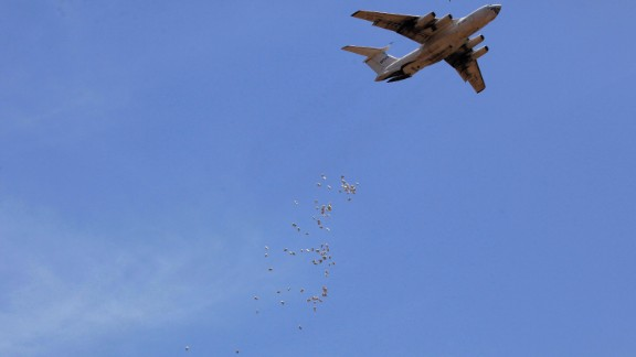 Bags of food are dropped from a plane during a World Food Program operation Tuesday, April 1, in Nyal, South Sudan.