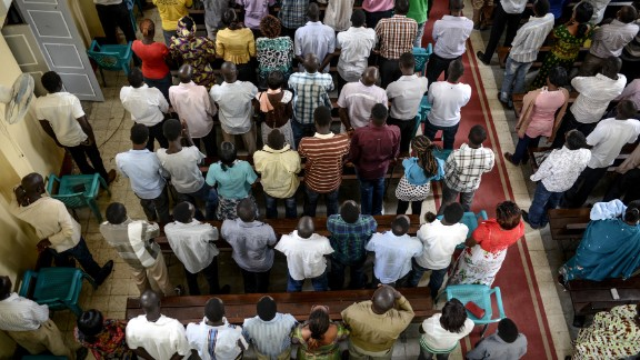 Catholics pray for peace during a religious ceremony in Juba on Sunday, February 23.
