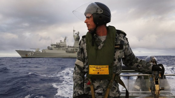 Leading Seaman, Boatswain's Mate, William Sharkey searching for debris on an inflatable boat as HMAS Perth searches for missing Malaysia Airlines flight MH 370 in the southern Indian Ocean on April 13.