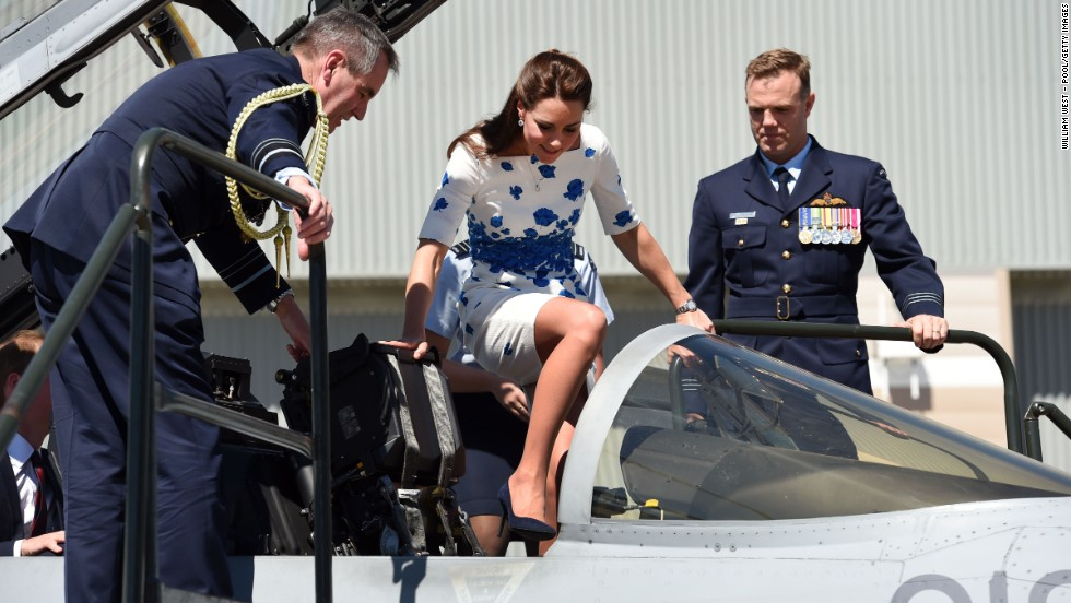Catherine steps into the cockpit of a RAAF Super Hornet with Air Marshall Geoff Brown and Wing Commander Stephen Chappell at her side on Saturday, April 19.