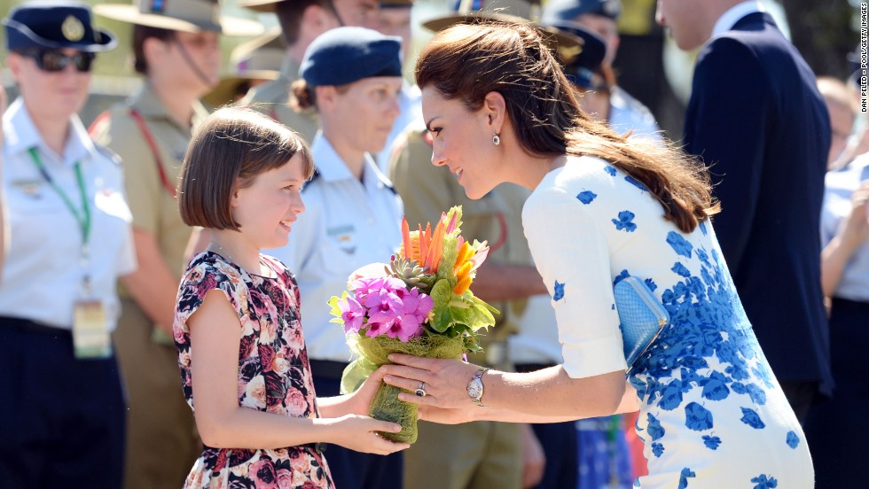 Catherine receives flowers from 9-year-old Ashleigh Kearnan during a visit to the Royal Australian Air Force Base at Amberley on April 19.