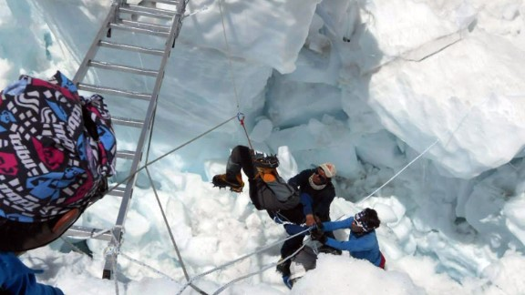 Nepalese rescue team members rescue a survivor of an avalanche on Mount Everest on Friday, April 18.