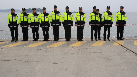 Police officers in Jindo stand guard Saturday, April 19, to prevent relatives of the ferry