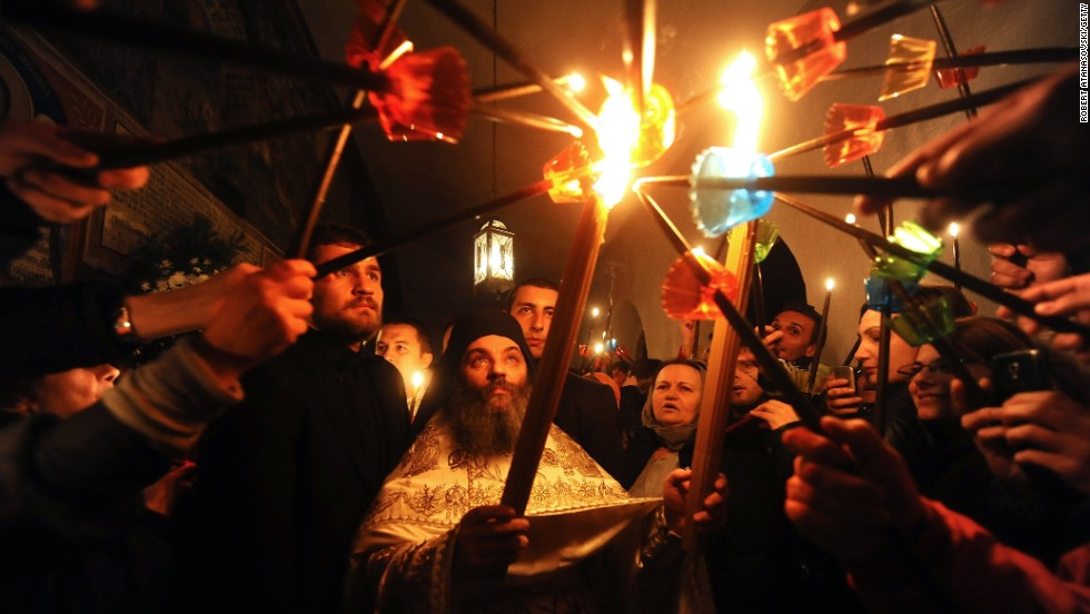Macedonian Orthodox Christians light candles from the holy fire that arrived from Jerusalem during an Easter service at the St. Jovan Bigorski Monastery in Mavrovo, Macedonia.