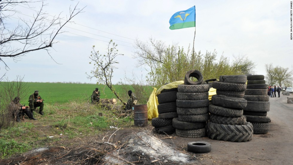 Armed pro-Russian militants stand guard at a roadblock near Slovyansk on April 20.
