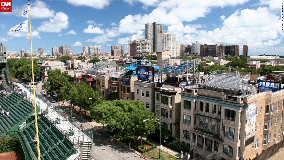 "Ondrovic also photographed houses in Wrigleyville, the neighborhood that surrounds the ballpark. Several residential buildings surrounding the park have <a href=""http://www.ballparkrooftops.com/"" target=""_blank"">bleachers on their rooftops</a>."