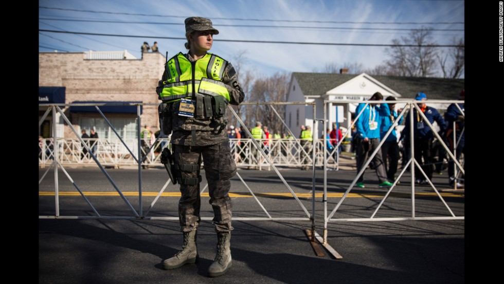A military police officer stands guard near the starting line of the Boston Marathon in Hopkinton on April 21.