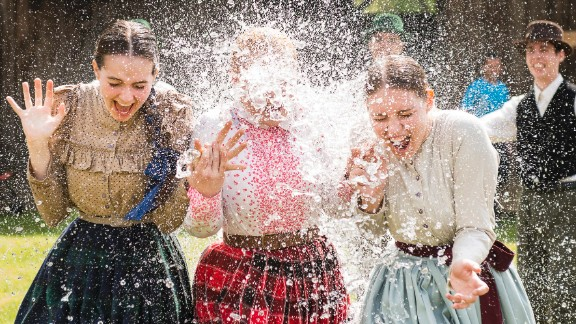 Women in traditional costumes are sprayed with water by men as members of the Marghareta Dance Group perform Easter folk traditions of the region in the Museum Village in Nyiregyhaza, northeast of Budapest, Hungary, on Monday, April 21. Click through the gallery to see how Christians around the world are observing Holy Week, which marks the last week of Lent and the beginning of Easter celebrations.