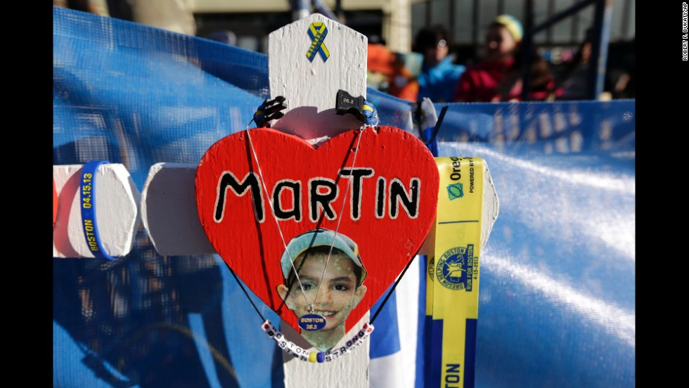 A memorial for Martin Richard, one of the 2013 bombing victims, stands near the starting line.