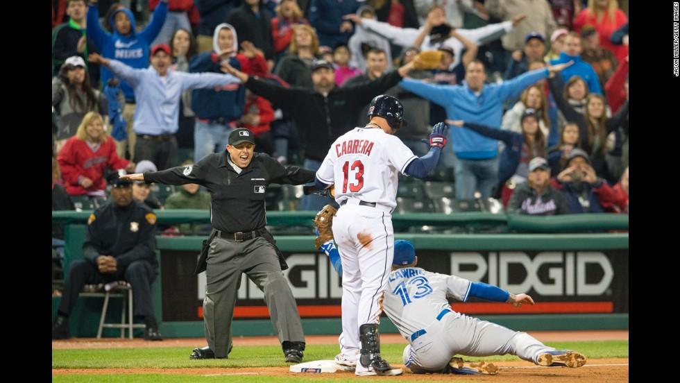 The crowd at Progressive Field in Cleveland helps third base umpire Tim Welke call Cleveland Indians baserunner Asdrúbal Cabrera safe on April 18.