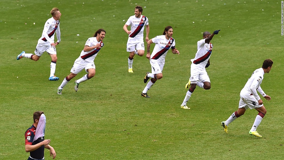 Cagliari teammates celebrate after Victor Ibarbo (second from right) scores his team's second goal during the Series A match between Genoa CFC and Cagliari Calcio on April 19 in Genoa, Italy.