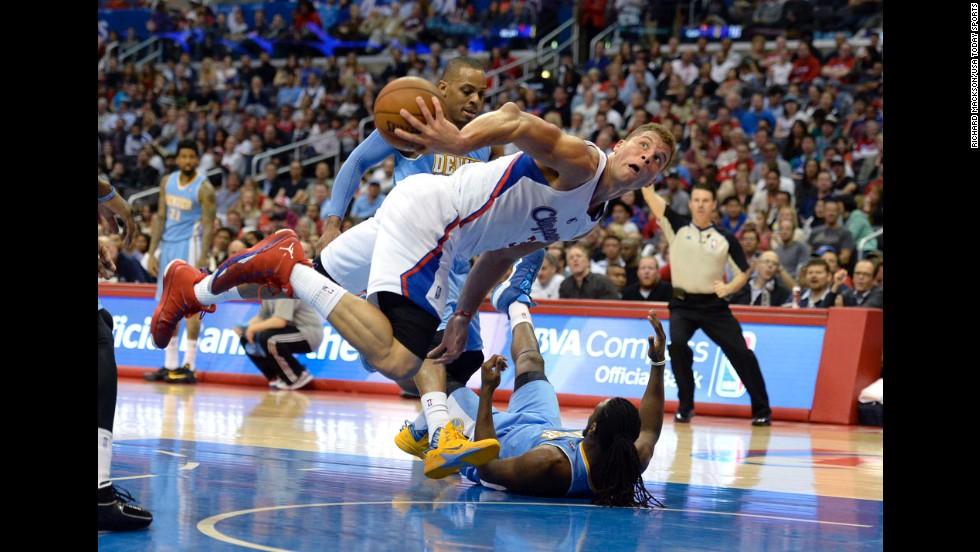 Los Angeles Clippers forward Blake Griffin passes the ball after colliding with Denver Nuggets forward Kenneth Faried during the second half on April 15 in Los Angeles.