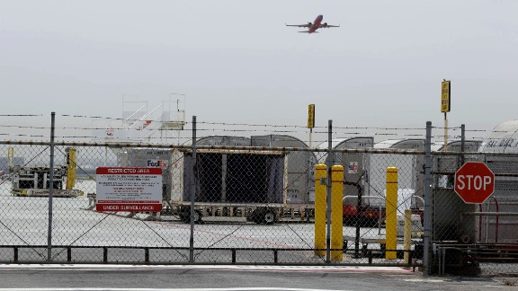 A plane takes off at Mineta San Jose International Airport, Monday, April 21, 2014, in San Jose, Calif. A 16-year-old boy scrambled over a fence at the airport, crossed a tarmac and climbed into a jetliner