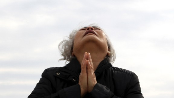 A relative of a ferry passenger prays as she waits for news in Jindo on April 22.
