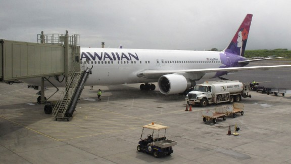 Hawaiian Airlines Flight 45 arrives from San Jose, Calif., in Kahului Airport in Kahului, Hawaii, on Monday, April 21, 2014. A 15-year-old boy on Sunday scrambled over an airport fence, crossed a tarmac and climbed into a jetliner's wheel well, then flew for five freezing hours to Hawaii on a misadventure that forced authorities to take a hard look at the security system that protects the nation's airline fleet. (AP Photo/Oskar Garcia)