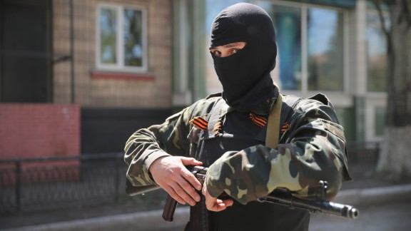 A pro-Russian militant stands guard in front of the occupied Ukraine Security Service building on April 21, 2014 in Slovyansk, Ukraine.