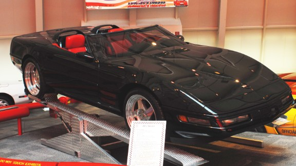 """This 1993 ZR-1 Spyder, on loan from General Motors, was built with""""unique hood and front quarter panel vents"""" to help cool the engine. The car's windshield and side glass were designed to sit lower than other Corvettes to give it an even sleeker profile. Although the museum lists this modified car's year as 1993, mechanically, the Spyder is a stock 1990,<a href=""""http://corvettemuseum.blogspot.com/2014/04/zr-1-spyder-recovered-from-sinkhole.html"""" target=""""_blank"""" target=""""_blank""""> according to the museum</a>."""