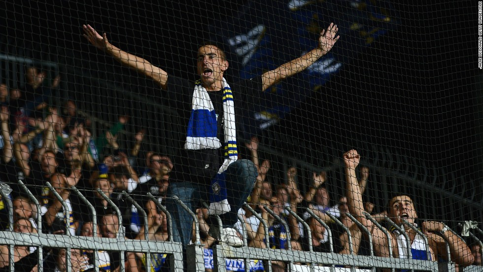 A Bosnian fan leads the chants at the Štadión pod Dubňom before the World Cup Group G qualifier against Slovakia in September 2013.