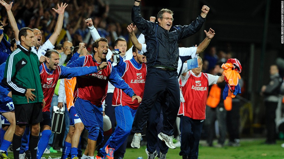 Bosnia's coach Safet Susic (C) leads the celebrates as the final whistle blows.