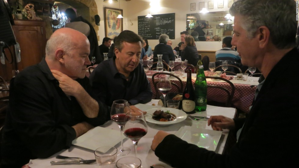 "Boulud, Buford and Bourdain dine at Bouchon Comptoir Abel. ""People come here to unwind, relax and eat with abandon,"" Bourdain says."