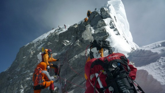 In this May 19, 2009 file photograph, unidentified mountaineers walk past the Hillary Step while pushing for the summit of Mount Everest as they climb the south face from Nepal.