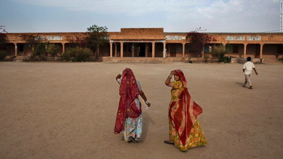 Women arrive to vote at a polling station on April 17, in the desert state of Rajasthan.