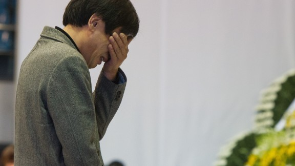A man reacts as he visits a group memorial altar for the victims from the sunken South Korean ferry 'Sewol' at the Ansan Olympic memorial hall on April 23, 2014.