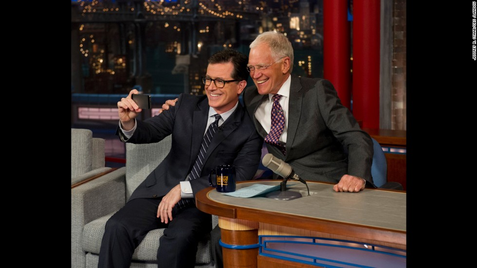 "Colbert <a href=""http://www.cnn.com/2014/04/23/showbiz/stephen-colbert-david-letterman-appearance/index.html?hpt=hp_c3"">takes a selfie </a>with Letterman on the ""Late Show with David Letterman"" in April 2014. CBS began to introduce the next host of the ""Late Show"" by having its current host interview him."