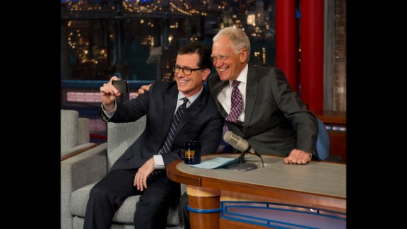 """Colbert takes a selfie with Letterman on the """"Late Show with David Letterman"""" in April 2014. CBS began to introduce the next host of the """"Late Show"""" by having its current host interview him."""