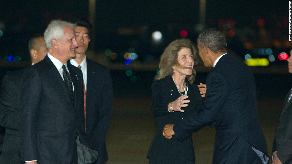 Kennedy greets Obama upon his arrival in Tokyo on April 23.