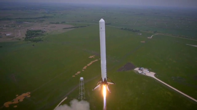 Reusable rocket takes off, then LANDS!