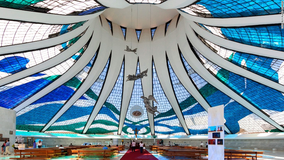 "Another marvel by Oscar Niemeyer, the 40-meter-high Cathedral of Brasilia and its suspended angels are bathed with natural light shining through the stained glass. The circular structure has glass ceilings that start at the floor, supported by 16 curved columns. The cathedral can hold up to 4,000 people.<a href=""http://catedral.org.br/"" target=""_blank""><em><br />Metropolitan Cathedral of Brasília<em></a></em>, Esplanada dos Ministérios, lote 12, Brasília; +55 61 3224 4073 </em>"