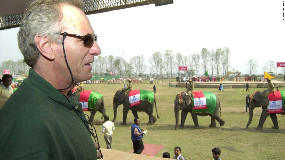 Shand, brand ambassador for Kaziranga National Park, watches as elephants parade during the park's centenary celebration in Kaziranga, India, on February 12, 2005.