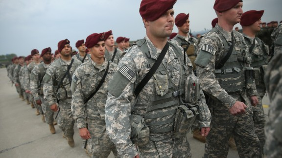 Members of the U.S. Army 173rd Airborne Brigade march after attending a welcome ceremony upon their arrival by plane at a Polish air force base on April 23, 2014 in Swidwin, Poland.
