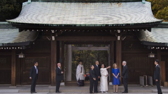 Obama was accompanied to the shrine by U.S. Ambassador to Japan Caroline Kennedy, in blue, and her husband, Edwin Schlossberg, second from right.