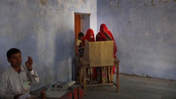 Indian women cast their vote at a village near Sawai Madhopur, India, on Thursday, April 24.