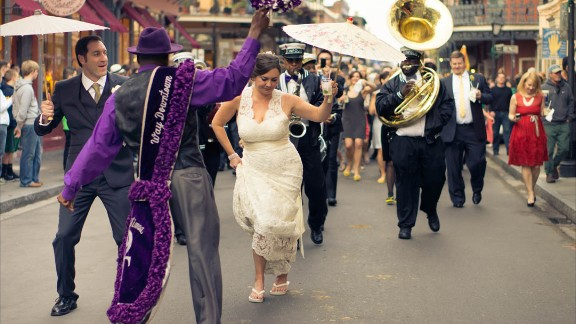 Consider deputizing wedding party or family members to convey the message if there is a special theme or structure to the food. In a traditional New Orleans wedding, there is no sit down meal -- the heavy passed apps and small plates stations ARE the dinner and guests shouldn
