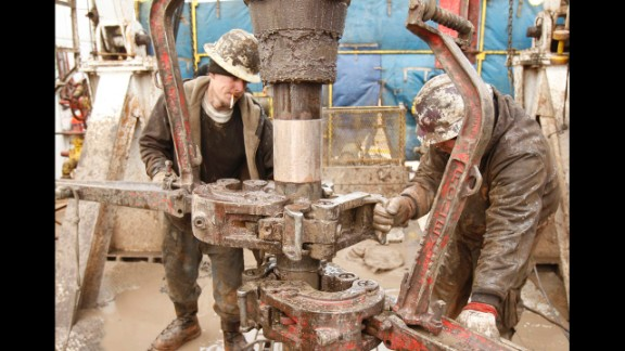 Rig workers drill a saltwater well to get fluids to be used in a fracking operation in Anthony, Kansas, in February 2012.