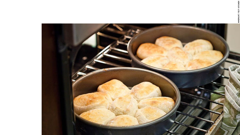11. Place cake pans in the oven and bake until the tops of the rolls are brown.