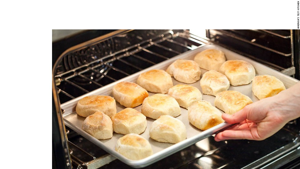 13. When rolls are cool enough to handle, turn right-side up, pull apart, and space evenly on baking sheet. Place baking sheet in oven.